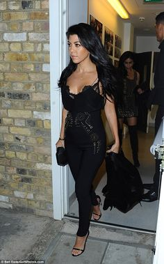 Sizzling! Kourtney looked ready to take the city by storm on Monday evening as she stepped out in a racy outfit comprised of a black form-fitting embellished jumpsuit which flashed a hint of her lacy bra