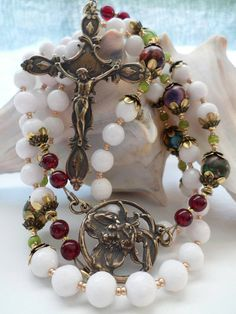 Check out this item in my Etsy shop https://www.etsy.com/listing/270963062/handmade-rosary-go-to-joseph