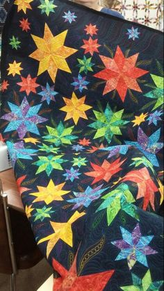 Lemoyne Star quilt made using Rapid Fire Lemoyne Star Ruler. Quilted by Deb Barlow.
