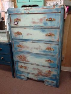 $220 - Painted several shades of blue and heavily distressed this waterfall style chest of drawers still maintains the original vintage Hardware. The dresser measures 34 inches across the front , 19 inches deep and it stands 51 inches tall. It can be seen in booth D8 at Main Street Antique Mall 7260 East Main St ( E of Power Rd ) Mesa 85207  480 9241122open 7 days 10 till 530 Cash or charge 30 day layaway also available