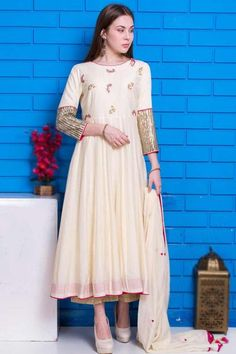Featuring beautiful embroidery, this off white cotton silk anarkali suit which makes you appealing. This round neck and 3/4th sleeve party wear suit perfectly formed using cutdana, sequins, and thread work. Accompanied by a matching cotton silk palazzo pant in off white color with off white cotton silk dupatta. Palazzo pant is plain. Dupatta decorated using thread work. #anarkalisuit #usa #Indianwear #Indiandresses #andaazfashion