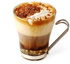 Caribbean Coffee. This coffee drink combines the great aroma of black coffee with dark rum, a bit of brown sugar and some coconut extract optionally. On the top goes whipped cream and grated chocolate.