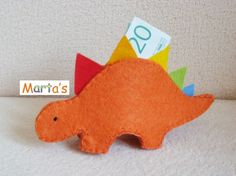 felt dinosaur as piggy bank