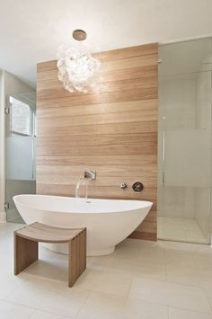 Love the accent wall behind the tub and the tub itself.  Like the flooring.