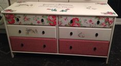 upcycled chest of drawers . I used the fabric from a blind that I got for £1 at a car boot sale for the top 2 drawers . I used a table runner for the bottom 2 drawers . The bows on the top drawers were off the table runner . I used a french typography graphic from www.thegraphicsfairy.com and vintage postcard graphics on the middle drawers and top that i got from here . I used homemade mod podge and a staple gun to attach the fabric :) xx