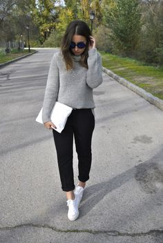 Dress in a grey knit turtleneck and black chinos to effortlessly deal with whatever this day throws at you. Throw in a pair of white low top sneakers for a more relaxed aesthetic. Shop this look for $75: http://lookastic.com/women/looks/sunglasses-turtleneck-clutch-chinos-low-top-sneakers/6648 — Navy Sunglasses — Grey Knit Turtleneck — White Leather Clutch — Black Chinos — White Low Top Sneakers