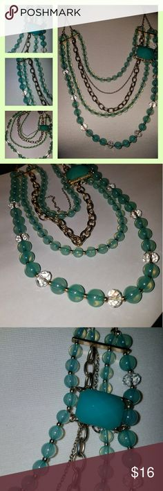 """Sea Foam Multi Strand Beautiful multi strand necklace.  Longest strand 28"""". Sea foam & clear beads separated  w/ goldtone seed beads.  Two strands are goldtone chain. No Marking Jewelry Necklaces"""