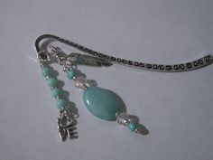 Large turquoise bead and aqua beads and clear Swarovski crystal beads in this bookmark.