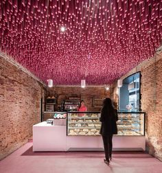 in the heart of alcalá de henares in madrid, local firm ideo arquitectura has renovated a 150-year-old plot as a colorful, contemporary bakery.