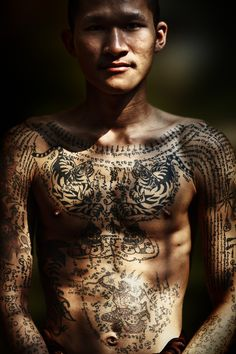 Burmese monk on his first pilgrimage. The novice is covered with beautiful animist tatoos from ascendant medicine books.