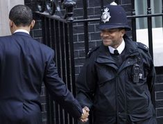 Obama and the bobby at 10 Downing Street.  What is this Black British police officer's name?  April 2009.  Found it!  PC Michael Zamora.