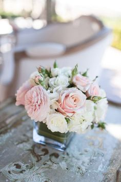Blush pink, ivory, and white, low and compact centerpiece.