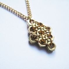 a geometric necklace made from simple materials