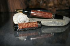 The Monroe Series Rollerball Pen finished in a beautiful Burled Redwood from California and trimmed in Gold & Sterling Silver. Luxurious and only $120.