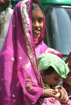 Lady in Pink with baby, Delhi. India.