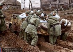 The Russian Hell: Vinnytsia region (Ukraine) on November 1943. German soldier of 1st SS Panzer Division Leibstandarte SS Adolf Hitler (LSSAHSS) try to move a Kubelwagen T82 out of deep mud.