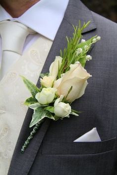 The Bride Groom's rather special boutonniere of fresh Lily of the Valley, Fragrant Rosemary, Rolled Rose Petals, Gracia Creme and 4 Good tiny buds and a beautiful Quicksand Rose