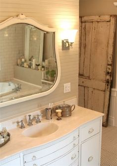 Love the old & new combo of design in this BR. Aged door, vintage-looking mirror, fresh white-painted walls