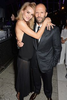 Playful: Rosie Huntington-Whiteley and Jason Statham continued what is fast becoming a rec...