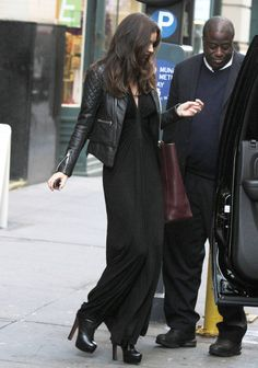 Miranda Kerr layered a quilted black leather jacket over a simply draped maxi dress in NYC.