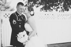 Military wedding kiss.