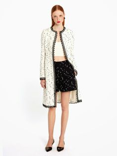 Oscar+de+la+Renta+black+and+white+flocked+dot+tweed+shorts+and+coat+with+stretch+knit+bandeau.jpg (903×1200)