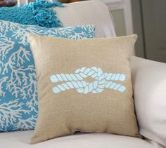 13 Classic Nautical Designs that Connect you to the Sea - stenciled rope design on pillow