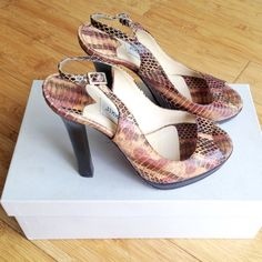 """Gorgeous snakeskin Jimmy Choo heels authentic These 4 1/2"""" heels are a stunning addition to any outfit. They are still in good condition and come with Jimmy Choo box and dust bag. Small stain inside the shoe--not sure from what, but most likely pizza? I can't wear high heels anymore so my loss is your gain! Sorry, trades. Follow my insta: @haute_hustle Jimmy Choo Shoes Heels"""