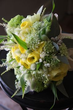 ranunculus,scabiosa,astilbe,Lagurus ovatus 'Bunny Tail' and lily of the valley