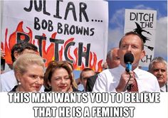 """Australia's Prime Minister and self-appointed Minister for Women, Tony Abbott, with a sign describing his predecessor, then Prime Minister Julia Gillard, as """"JuLIAR - Bob Brown's Bitch"""" and another sign reading """"Ditch the Witch"""" referring to Ms Gillard. One can't help but wonder whatever gave him the impression he would be suitable for the position of Minister for Women. Minister for Sexism, yes. Minister for Misogyny, yes. But NOT Minister for Women! #auspol #australia #tonyabbott"""