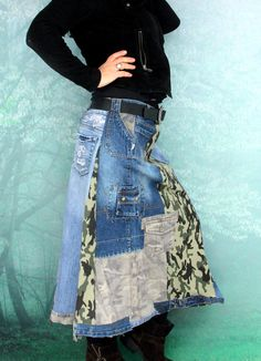 Camo military denim patchwork skirt. Made from recycled clothing. Remade, reused and upcycled. Military style. Very useful and comfortable. Hippie boho. One of a kind. Size: M-L (european 38-40) you can wear it on waist level or hips level and regulate with belt. Uper line (belt) (waist level or hips level) a little stretching - 33-38 inches (84-96 cm) Hips max 44 inches (112 cm) Length about 33 inches (84 cm)