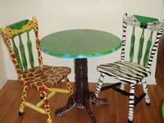 Giraffe & Zebra Chair & Table Set by Jennifer Brown  Giraffe Chair, Zebra Chair and Tree Table. Perfect for a child's bedroom, the kitchen or to add flair in any room! They are very sturdy, up-cycled, and have been given lots of new life. Guaranteed to put a smile on your face every time you see them.  Price: $599.00  On Artful Vision, www.artfulvision.com a portion of your purchase is donated to a participating non-profit of your choice. #art #home #decor #wood #chair #kids #table #zebra