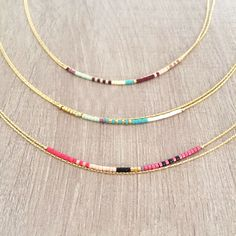 Delicate double strand necklace made of thin golden chain with a colorful beaded accent. ♡ Three color options available :) All materials are plated with a thin layer of pure gold, offering a durable plating at an affordable price.  Simple yet elegant, this necklace looks adorable by itself but is also ideal to layer with longer pieces !  Please choose your desired length & color while adding to cart ! The length worn by the model of the photo is 16.5 (42 cm).  All materials are nickel-fr...