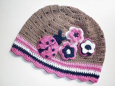 Crochet hat with a ladybug