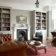 fireplace is recessed, bookcases to ceiling. Where's the marlin go? ... Victorian living room