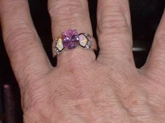 LOOK!!!!!! A BEAUTIFUL STERLING SILVER GENUINE PINK TOPAZ AND PINK FIRE OPAL…