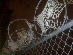 guerrilla crochet; so dainty against the barbed wire