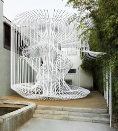 Designed by Warren Techentin Architecture, 'la cage aux folles' is a temporary structure occupying a street front courtyard located in Los Angeles, California.