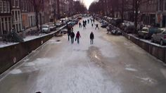 """Ice skating in Amsterdam... This afternoon riding my bike along the canals of Amsterdam, my home town, I saw many people young and old alike skating happily on the frozen canals. I myself hate cold ice and skating, but I couldn't stay icy watching these folks enjoying the ice and the skating so much. A bit further on I saw another typically dutch phenomenon: """"Koek en Zopie"""" (don't even try to pronounce it if you don't speak Dutch ((-:[=  ).These are tables placed on the ice..."""