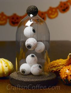 "How to make a Halloween cloche from a soda bottle. Perfect for displaying your Halloween ""eyeball"" collection."