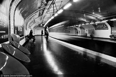 #Lamarck station in #Paris metro. I set the camera on my knee, or maybe the chair, & did a long exposure as the train came speeding in.  There's John Anthony aka @redvoid standing next to the platform.