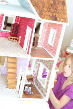 Sarah Jane Studios did this extreme fixer-upper dollhouse as a display for fabric designs. I sort of want to move in.