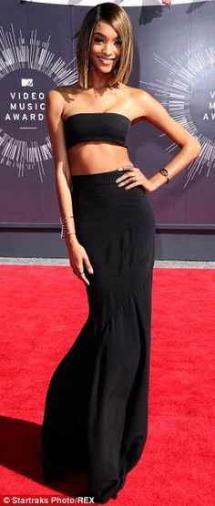 Abs-tastic: Jourdan Dunn displayed her toned tummy in a bandeau top and long skirt at the ...