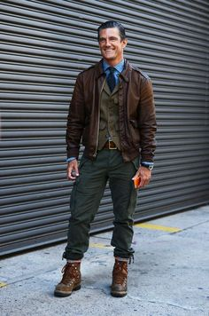Rock a dark brown leather barn jacket with dark green cargo pants for a trendy and easy going look. Turn your sartorial beast mode on and grab a pair of dark brown leather boots.  Shop this look for $413:  http://lookastic.com/men/looks/longsleeve-shirt-tie-waistcoat-barn-jacket-belt-cargo-pants-boots/4289  — Blue Longsleeve Shirt  — Navy Print Tie  — Olive Waistcoat  — Dark Brown Leather Barn Jacket  — Dark Brown Leather Belt  — Dark Green Cargo Pants  — Dark Brown Leather Boots