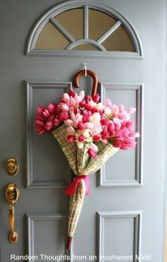 Umbrella door hanger filled with flowers for Spring baby shower