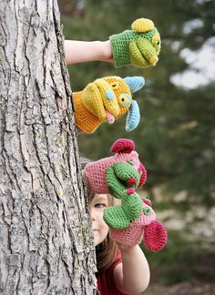 Crochet a pair or a pack—any beginner can adopt these fun-time puppies as mittens or hand puppets. Make your own lovable color combination. Woof! Pattern No. 9514