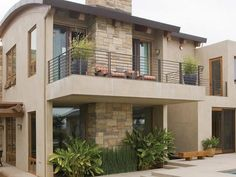 Gain inspiration for your color palette from your home's materials. This Southwest-style home uses tones of natural clay and dark brown, as seen in the natural stone and woodwork. Paint colors: Bonsai Pot and Sweet Molasses by Behr