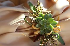 Succulent mother's corsage - so pretty with the raffia bow!
