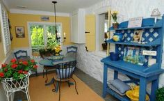 Cute mix of yellow, blue and white dinette.