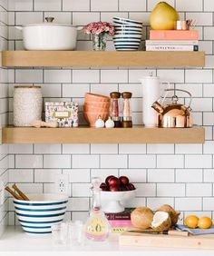 Peachy-keen kitchen shelfie shared by @alexandrajoywig, featured in @dotemagazine. Blue and peach colour scheme is so fresh for Spring. Add colour pops to an all-white kitchen with small bowls, a faux flower arrangement and even stacks of cookbooks.
